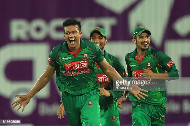 Bangladesh cricketers congratulate Taskin Ahmed after the dismissal of England cricketer Chris Woakes during the second one day international cricket...