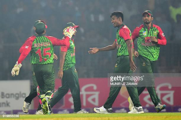Bangladesh cricketers congratulate teammate Mustafizur Rahman after the dismissal of the Sri Lanka cricketer Kusal Mendis during the second Twenty20...
