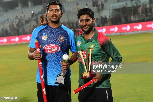 Bangladesh cricketers Imrul Kayes and Soumya Sarkar pose with their man of the series and man of the match awards following the presentation ceremony...