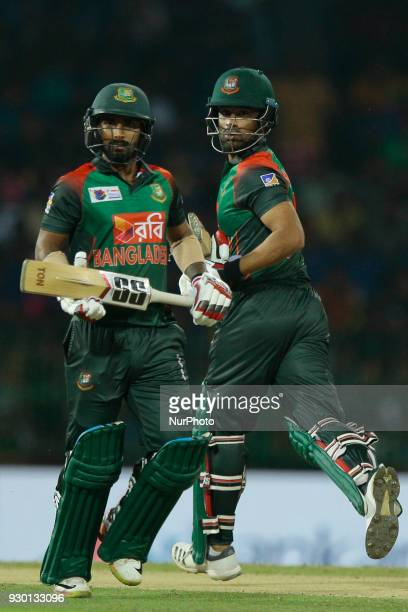 Bangladesh cricketers Liton Das and Tamim Iqbal run between the wickets during the 3rd T20 cricket match of NIDAHAS Trophy between Sri Lanka and...