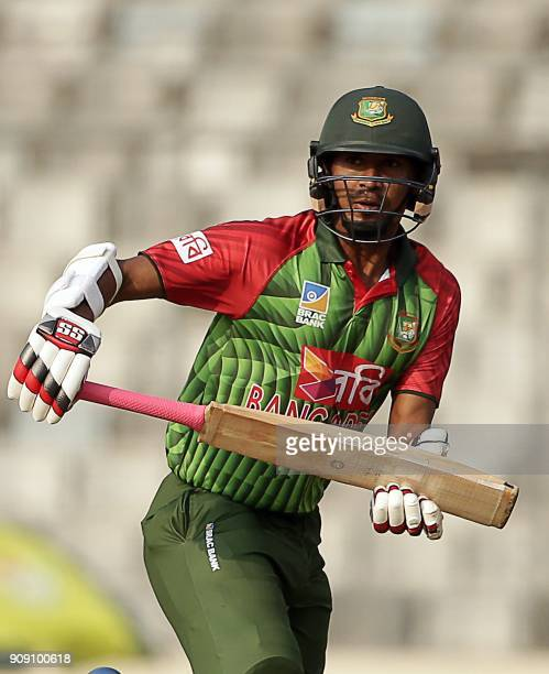Bangladesh cricketers Mustafizur Rahman runs between the wicket during the fifth one day international match in the TriNations Series between...