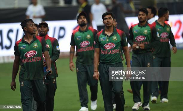 Bangladesh cricketers reacts after India require another 9 runs with 3 wickets during the final one day international Asia Cup cricket match between...