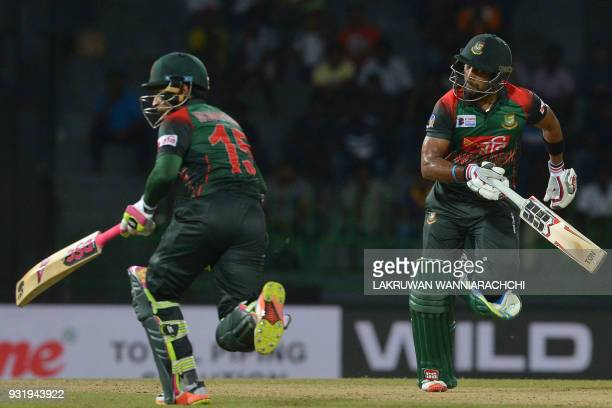 Bangladesh cricketers Sabbir Rahman and Mustafizur Rahman run between the wickets during the Fifth Match Nidahas Twenty20 TriSeries international...