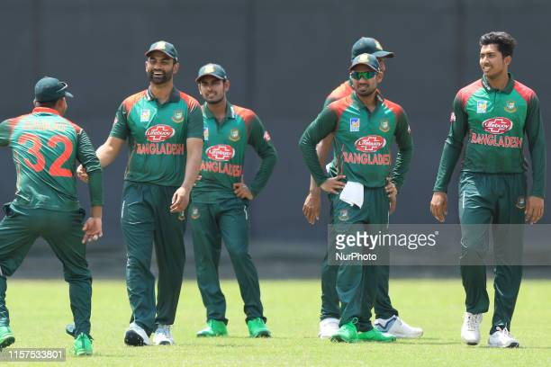 Bangladesh cricketers share a light moment after takes a wicket during the tour match between Sri Lanka Board President's XI and Bangladesh at P Sara...