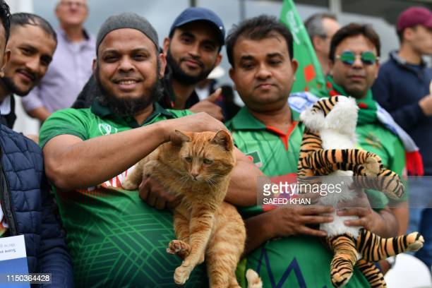 Bangladesh fan in the crowd holds Brian The Cat, the Somerset Cricket club cat, in the crowd during the 2019 Cricket World Cup group stage match...