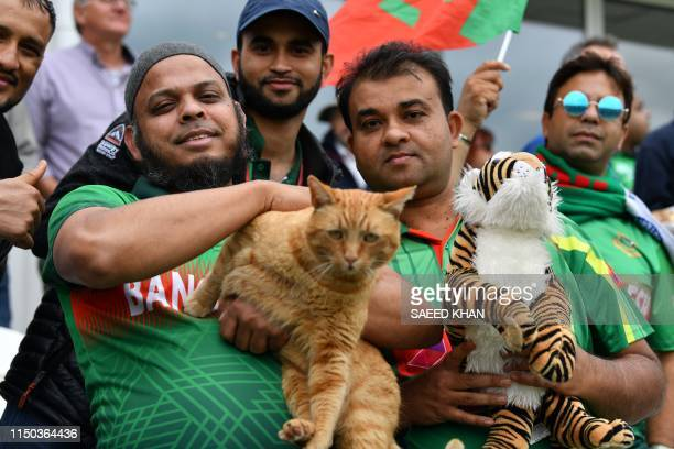A Bangladesh fan in the crowd holds Brian The Cat the Somerset Cricket club cat in the crowd during the 2019 Cricket World Cup group stage match...