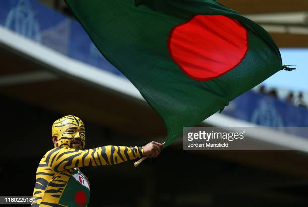 Bangladesh fan waves a flag in the crowd during the Group Stage match of the ICC Cricket World Cup 2019 between Pakistan and Bangladesh at Lords on...
