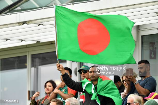 A Bangladesh fan waves a national flag during the 2019 Cricket World Cup group stage match between West Indies and Bangladesh at The County Ground in...