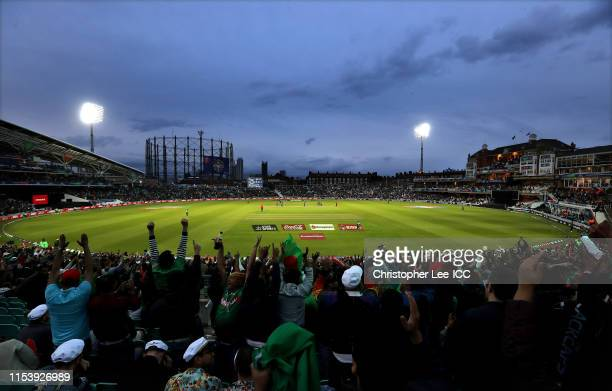 Bangladesh fans celebrate a wicket as the game is played under floodlights during the Group Stage match of the ICC Cricket World Cup 2019 between...