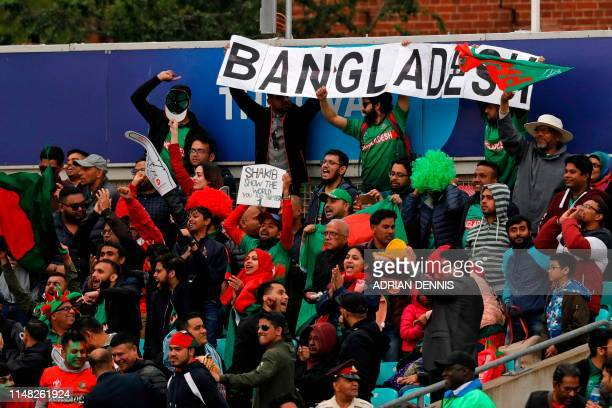 Bangladesh fans celebrate taking another wicket during the 2019 Cricket World Cup group stage match between Bangladesh and New Zealand at The Oval in...