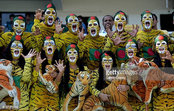 Bangladesh fans cheer during day three of the second Test match between Bangladesh and England at ShereBangla National Cricket Stadium on October 30...