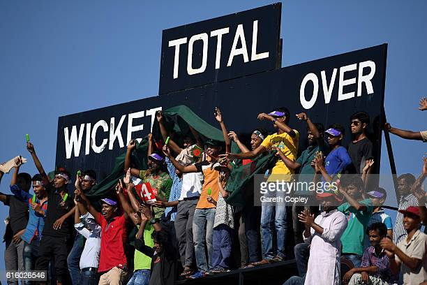 Bangladesh fans cheer on their team during day two of the first Test between Bangladesh and England at Zohur Ahmed Chowdhury Stadium on October 21...