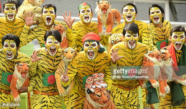 Bangladesh fans dressed as tigers pose during the second test match between Bangladesh and England at Shere Bangla National Stadium on October 28...