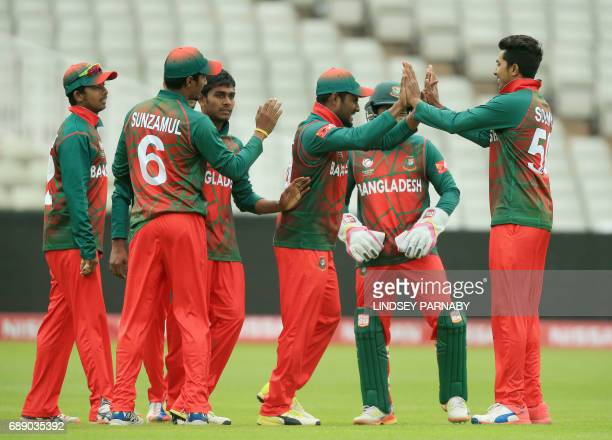 Bangladesh fielder Imrul Kayes celebrates with teammates after catching Pakistan batsman Shoaib Malik off teammate Shafiul Islam's bowling during an...