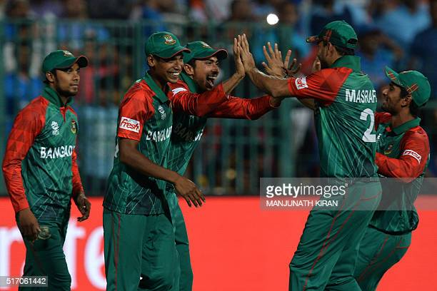 Bangladesh fielder Soumya Sarkar celebrates with teammates after taking a catch to dismiss Indian batsman Hardik Pandya during the World T20 cricket...