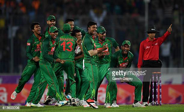 Bangladesh fielders celebrate the wicket England captain Jos Buttler during the 2nd One Day International match between Bangladesh and England at...