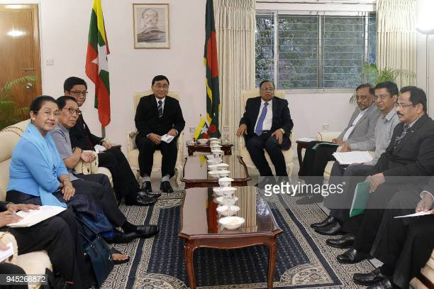 Bangladesh Foreign Minister Abul Hasan Mahmud Ali sits next to Myanmar Social Welfare Minister Win Myat Aye during their meeting in Dhaka on April 12...