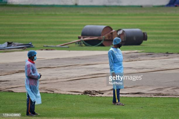 Bangladesh ground's man wear protective suit during working at Sher-e-Bangla National Cricket Stadium in Dhaka, Bangladesh on August 2, 2021. Ahead...