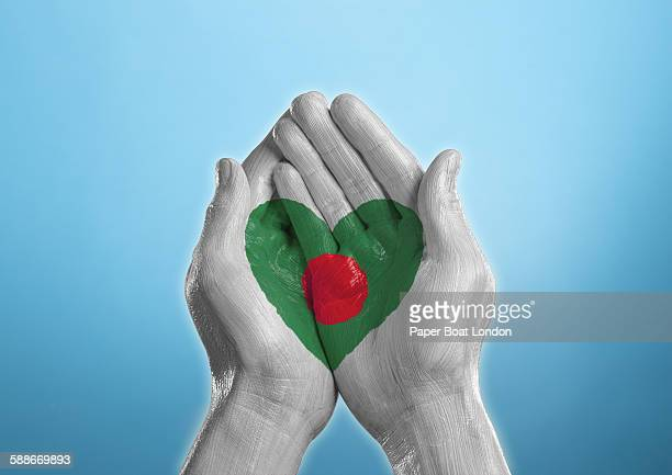 bangladesh heart shaped flag painted on a hand - flag of bangladesh stock pictures, royalty-free photos & images