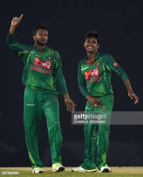 Bangladesh Mehedi Hasan celebrates with teammate Shakib Al Hasan after he dismissed Sri Lankan cricketer Lakshan Sandakan run out during the first...