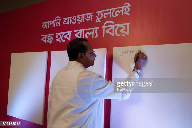Bangladesh Minister for Information Hasanul Haq Inu singe on the board during the launch program day in the Dhaka Bangladesh 31 July 2017 The...