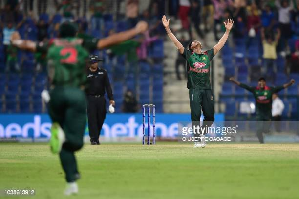 Bangladesh Mustafizur Rahman celebrates the victory during the one day international Asia Cup cricket match between Afghanistan and Bangladesh at The...
