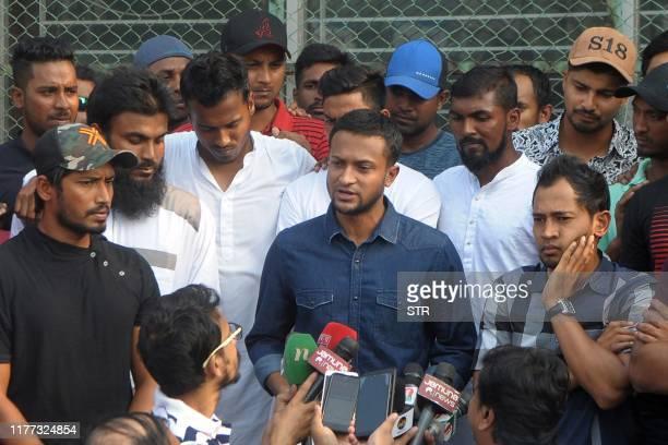 Bangladesh national cricket team captain Shakib Al Hasan speaks with journalist next to teammate Mushfiqur Rahim at the ShereBangla National Stadium...