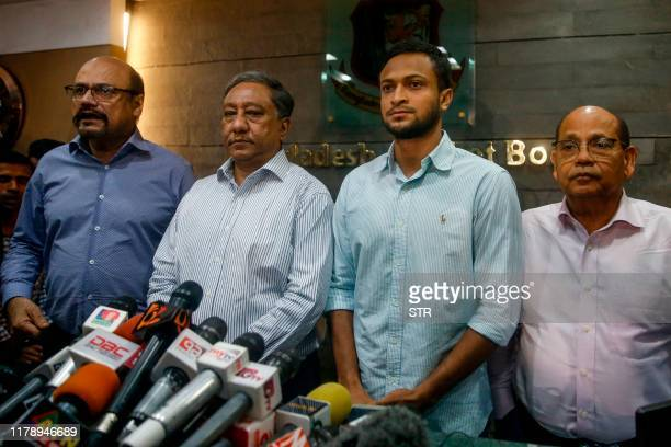 Bangladesh national cricket team captain Shakib Al Hasan speaks with media as Bangladesh Cricket Board president Nazmul Hassan Papon stands next to...