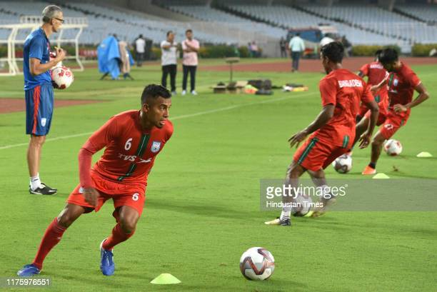 Bangladesh national Football player Jamal Bhuyan with jersey number 6 practises a day before the FIFA World Cup 2022 qualifier match against India at...