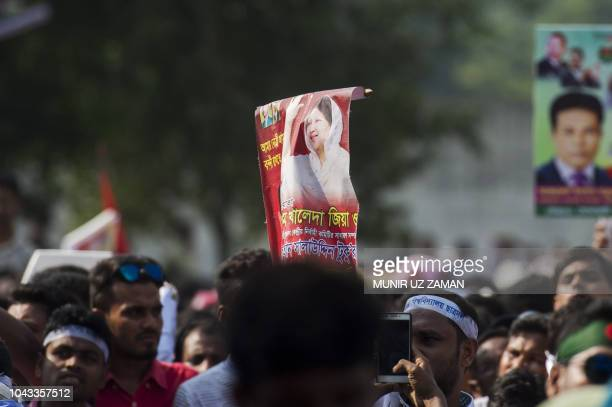 A Bangladesh Nationalist Party activist holds a placard with a picture of Khaleda Zia the chairperson of Bangladesh Nationalist Party during a rally...