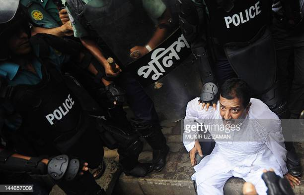 Bangladesh Nationalist Party leader Mizanur Rahman Minu reacts after a scuffle with police during a nationwide strike in Dhaka May 172012 Two small...