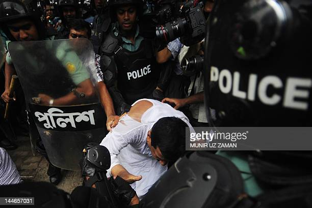 Bangladesh Nationalist Party leader Mizanur Rahman Minu scuffles with police during a nationwide strike in Dhaka May 172012 Two small bombs exploded...