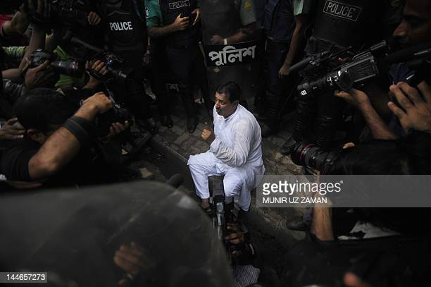 Bangladesh Nationalist Party leader Mizanur Rahman Minu speaks to the media after a scuffle with police during a nationwide strike in Dhaka May...