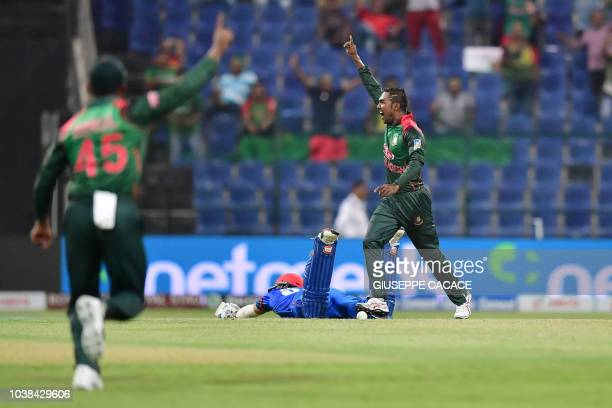 Bangladesh Nazmul Islam celebrates after he dismissed Afghanistan batsman Rahmat Shah during the one day international Asia Cup cricket match between...