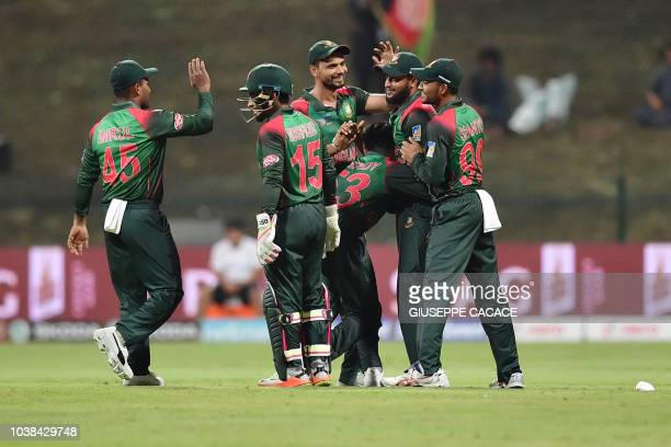 Bangladesh Nazmul Islam celebrates with his team after he dismissed Afghanistan batsman Rahmat Shah during the one day international Asia Cup cricket...