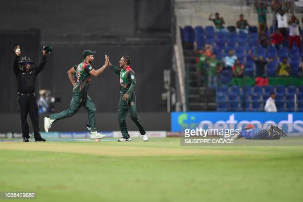 Bangladesh Nazmul Islam celebrates with Mashrafe Mortaza after he dismissed Afghanistan batsman Rahmat Shah during the one day international Asia Cup...
