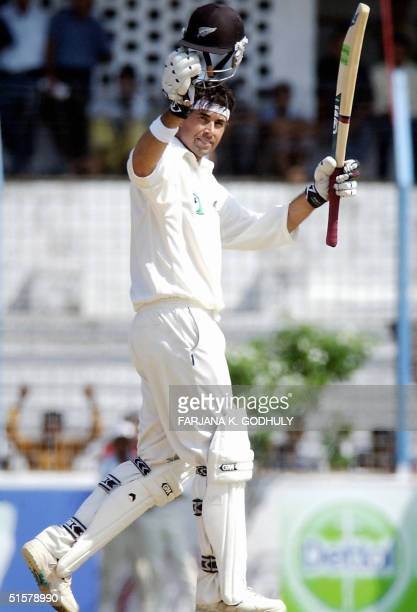 Bangladesh: New Zealand captain Stephen Fleming raises his bat after scoring a double century on the second day of the second test match between...