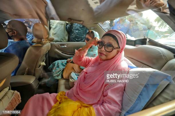 Bangladesh opposition leader Khaleda Zia sits in a car after being released for medical reasons from prison where she spent more than two years due...