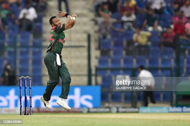 Bangladesh player Shakib Al Hasan bowls during the one day international Asia Cup cricket match between Afghanistan and Bangladesh at the Sheikh...