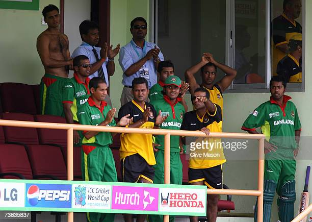 Bangladesh players applaud Mushfiqur Rahim of Bangladesh for his innings during the ICC Cricket World Cup Super Eights match between Bangladesh and...