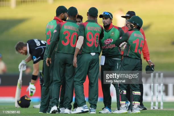 Bangladesh players celebrate a wicket during Game 1 of the One Day International series between New Zealand v Bangladesh at McLean Park on February...