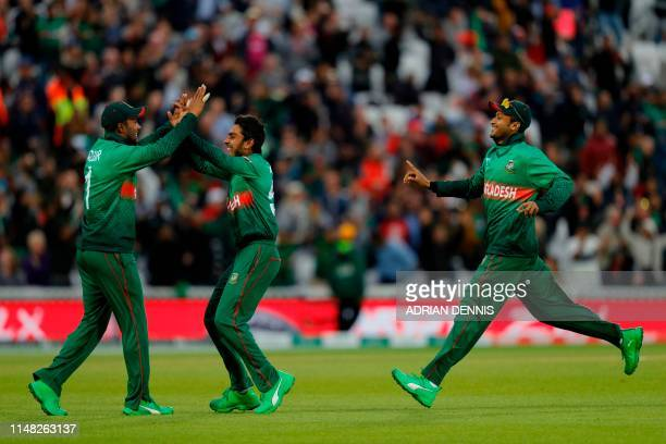 Bangladesh players celebrate after mistakenly thinking they'd run out New Zealand's James Neesham during the 2019 Cricket World Cup group stage match...