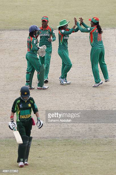 Bangladesh players celebrate after Sana Mir of Pakistan is dismissed during the cricket women's final match between Pakistan and Bangladesh on day...