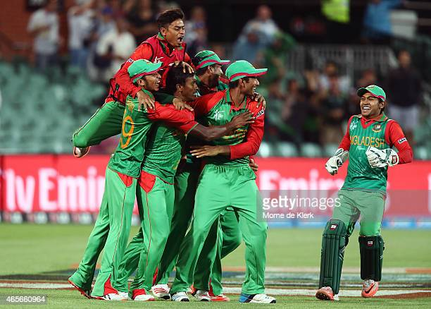 Bangladesh players celebrate after winning the 2015 ICC Cricket World Cup match between England and Bangladesh at Adelaide Oval on March 9 2015 in...