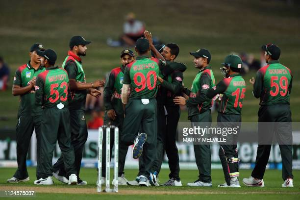 Bangladesh players celebrate the dismissal of New Zealand's captain Kane Williamson during the first oneday international cricket match between New...