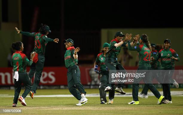 Bangladesh players celebrate the wicket of Deandra Dottin of West Indies during the ICC Women's World T20 2018 match between West Indies and...