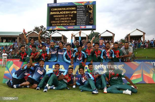 Bangladesh players celebrate with the trophy following victory during the ICC U19 Cricket World Cup Super League Final match between India and...