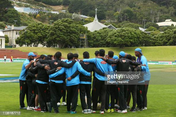 Bangladesh players form a huddle during day five of the second test match in the series between New Zealand and Bangladesh at Basin Reserve on March...