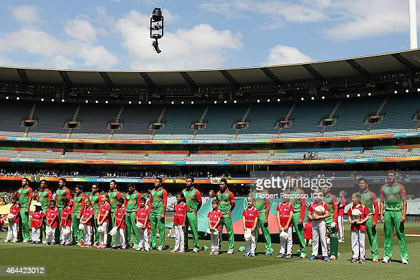 Bangladesh players line up for national anthems during the 2015 ICC Cricket World Cup match between Sri Lanka and Bangladesh at Melbourne Cricket...