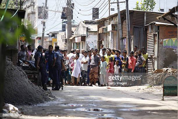 Bangladesh police attend the scene of an operation where they stormed a militant hideout in Narayanganj around 25 kms south of Dhaka and shot dead...
